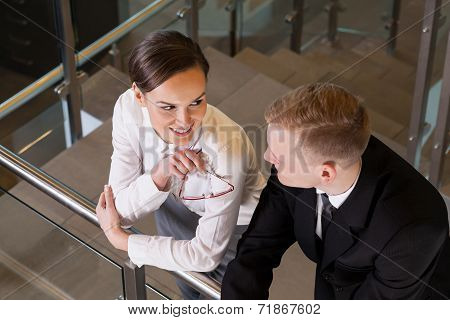 Attractive Businesswoman Coquetting Her Co-worker