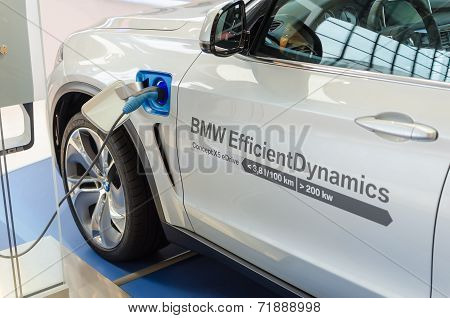New Model Of Bmw X5 With Hybrid Engine At Charging Station
