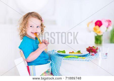 Little Girl Eating Salad For Lunch
