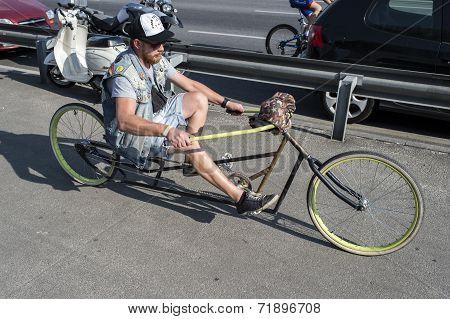 man driving bicycle chopper