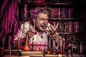 Crazy old man medieval scientist working in his laboratory. Alchemist. Halloween. poster