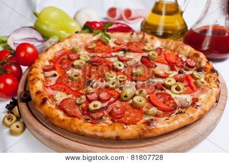 Pizza With Mozzarella, Ham And Olives
