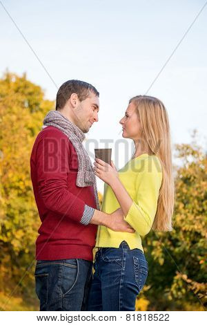 Young couple in love having a picnic at the park. Happy people in love walking in the woods hugging
