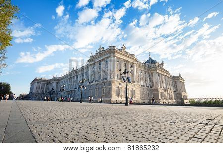 Royal Palace With Tourists On A Spring Day In Madrid