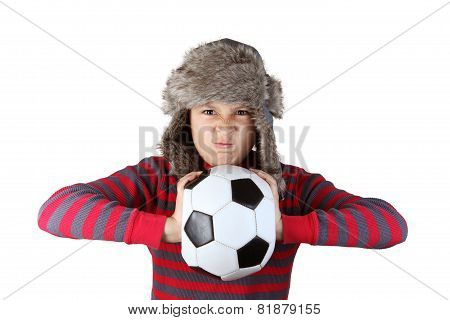 Boy in furry hat mad at football