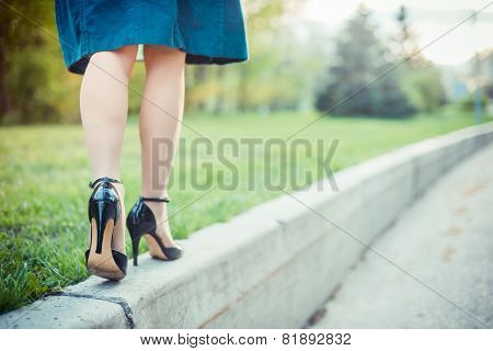 Woman is walking on a sunny day