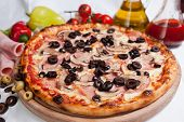 Pizza on wood, italian clasic food with ingredients around the pizza poster