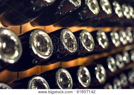 wine bottles in cellar. Selective focus
