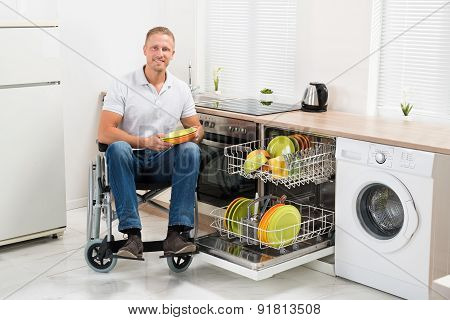 Disabled Man On Wheelchair In Kitchen