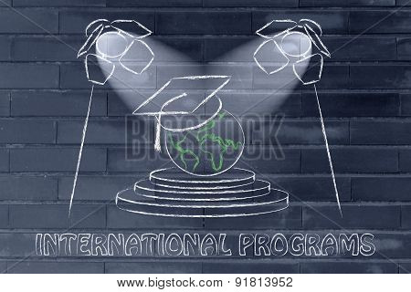 International Programs: World With Graduation Cap Under Spotlights