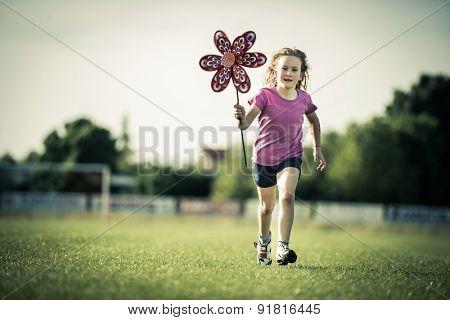 Young girl having fun with a pinwheel