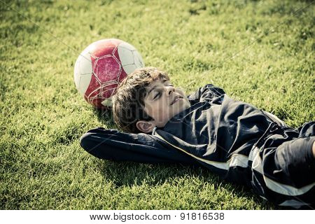 Girl lying on soccer field after the game
