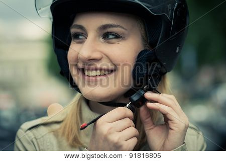 Teenage girl with helmet on her scooter