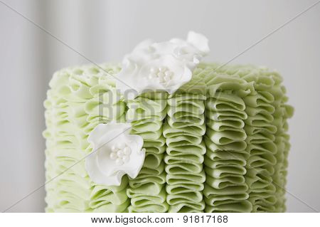 Cake With Fondant Ruffles And Sugar Flowers