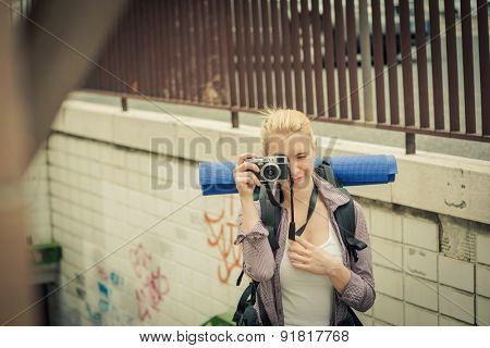 Young backpacker taking photos