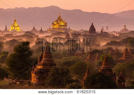 Pagoda landscape under a warm sunset in the plain of Bagan, Myanmar (Burma)