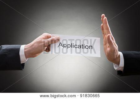 Businessman Avoiding Application Form