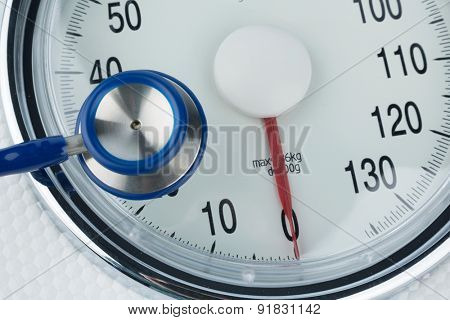 stethoscope and scale, symbol photo for weight, diet and heart disease