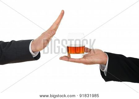 Businessman Refusing Alcohol Offered By His Colleague Over White Background poster