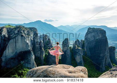 Woman enjoying nature on the mountains