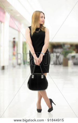 Young Woman Wearing Black Color Clothes