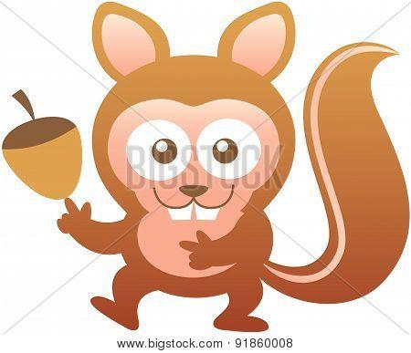 Cute friendly squirrel showing an acorn