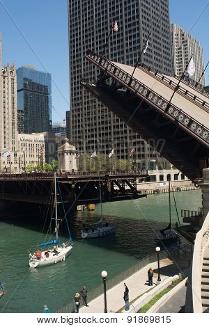 Chicago, IL - May 13, 2015 A drawbridge being raised over Chicago River at Michigan Ave