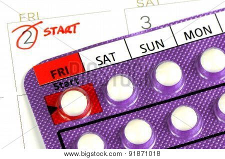 Strip of Contraceptive Pill on the Calendar.