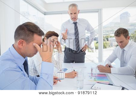 Businessman yelling at his team in the office