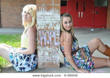 Two Girls Sitting Next To Hope