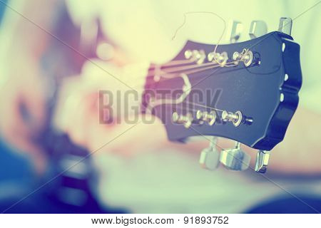 Vintage photo of guitarist on stage in the stagelight
