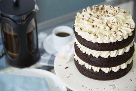Chocolate Layer Cake Served With Fresh Coffee