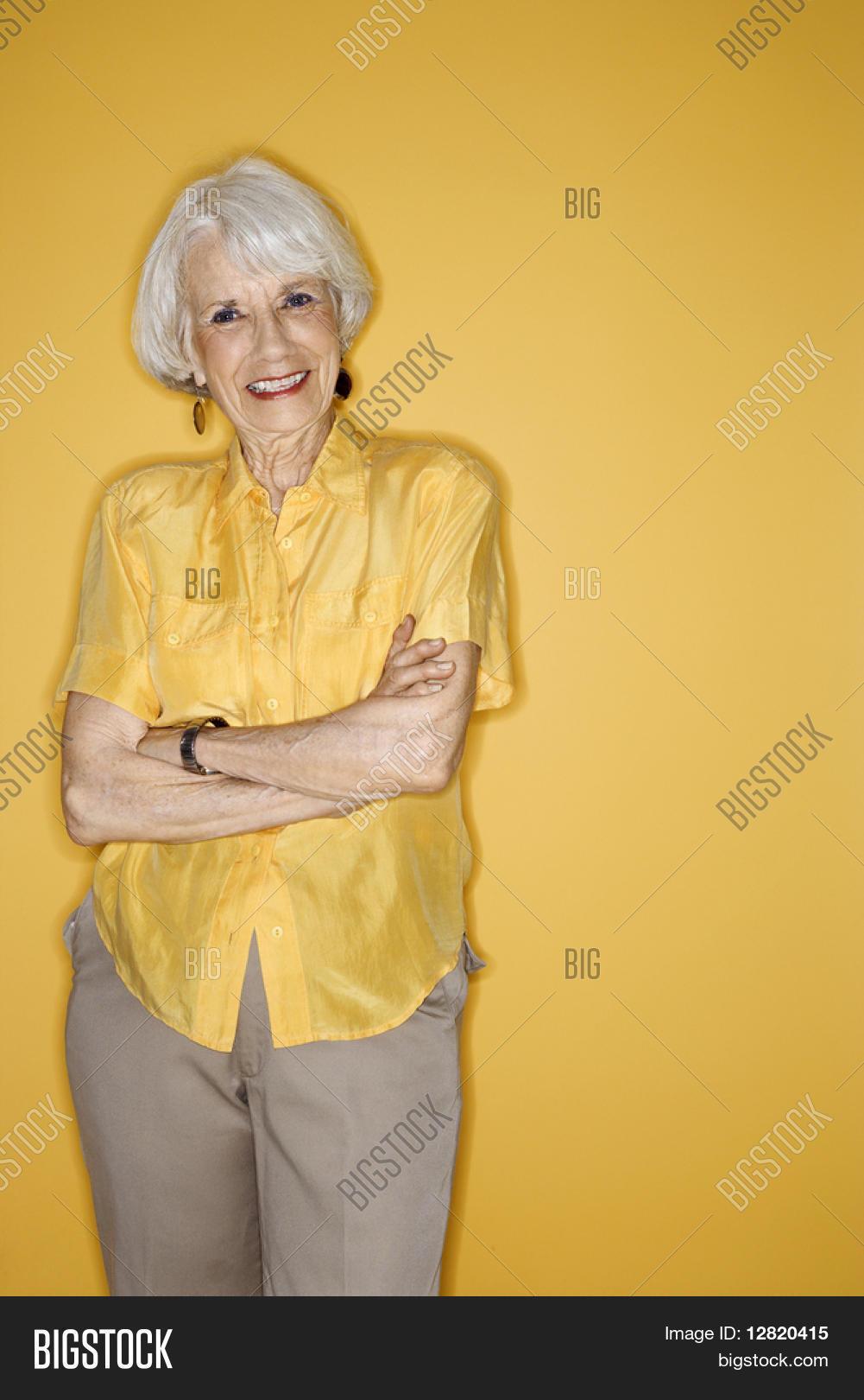 Caucasian mature adult female standing smiling.