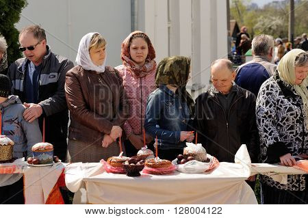 Orel Russia - April 30 2016: Paschal blessing of Easter baskets in Orthodox church. People waiting for kulich and eggs blessing horizontal
