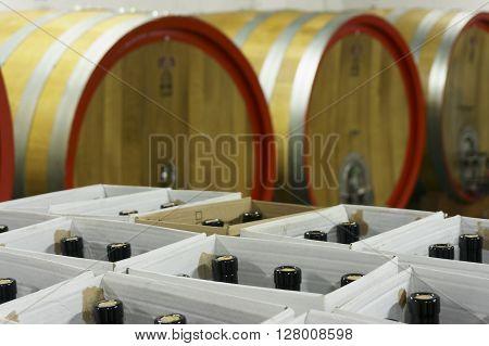 Filled Bottles In Cardboard Boxes In Underground Wine Cellar