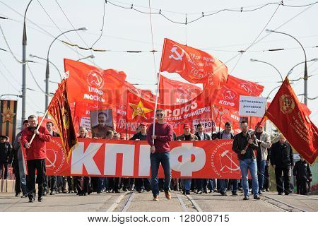 Orel Russia - May 1 2016: Communist party demonstration. Communists marching with banners and red flags horizontal