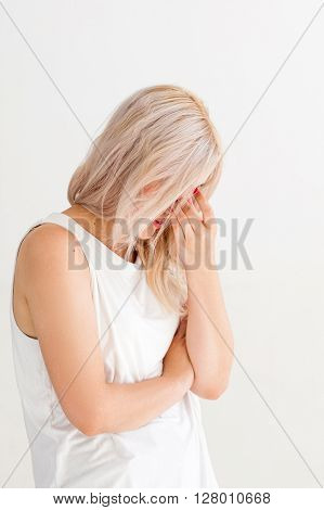 Tired woman with headache and problem. Unrecognizable sad disappointed girl. Family conflict, divorce, crisis, stress, quarrel and misunderstanding concept. Tired woman on white background.