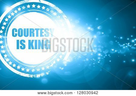 Blue stamp on a glittering background: courtesy is king