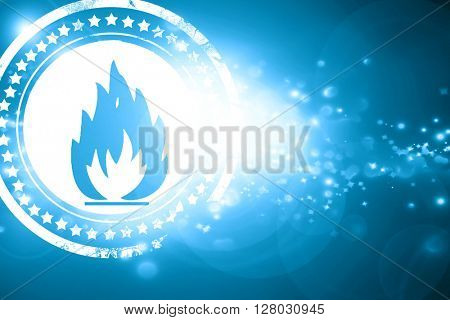 Blue stamp on a glittering background: Flammable hazard sign