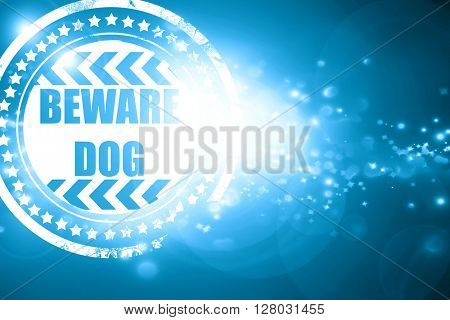 Blue stamp on a glittering background: Beware of dog sign
