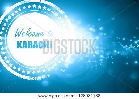 Blue stamp on a glittering background: Welcome to karachi