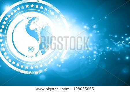 Blue stamp on a glittering background: Yin yang symbol