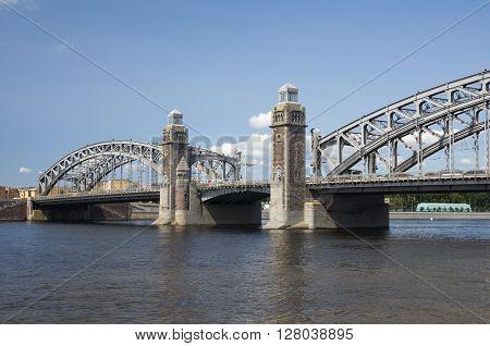 Bolsheokhtinsky bridge across Neva River in summer day also known as Peter the Great Bridge Saint-Petersburg Russia poster