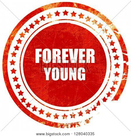 forever young, grunge red rubber stamp on a solid white backgrou