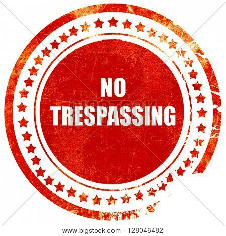No trespassing sign, grunge red rubber stamp on a solid white ba