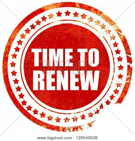 time to renew, grunge red rubber stamp on a solid white backgrou