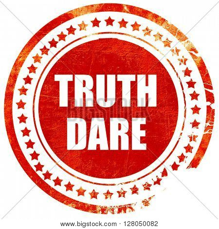 truth or dare, grunge red rubber stamp on a solid white backgrou