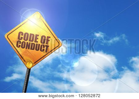 Yellow road sign with a blue sky and white clouds: code of conduct