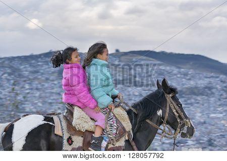 Two Girls Riding A Horse Quito Ecuador