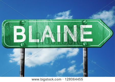 blaine road sign , worn and damaged look